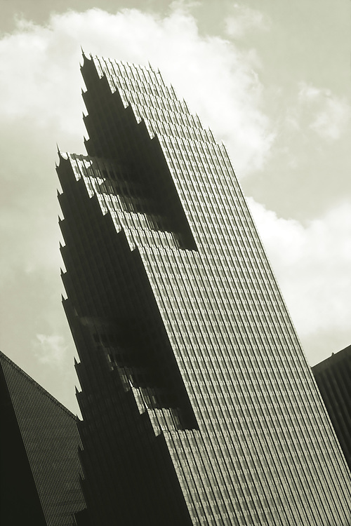 Published in an Ibanez Electric Guitar catalog. Architecture was used to represent Jazz guitars. This is the Republic Bank Tower in Houston, Texas, designed by Philip Johnson. Duotone image.