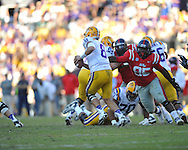 Ole Miss defensive tackle Bryon Bennett (95) rushes LSU quarterback Zach Mettenberger (8) at Tiger Stadium in Baton Rouge, La. on Saturday, November 17, 2012.....