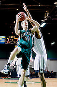 Christ School's Marshall Plumlee #40 drives inside. Plumlee is a Duke recruit.