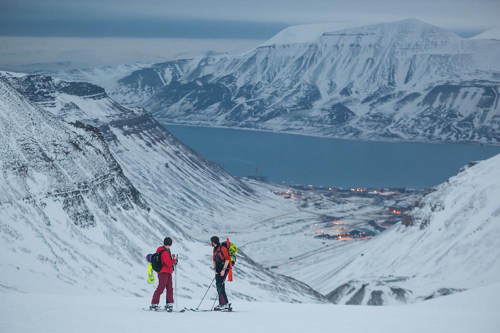 Michelle Blade (left) and Nate Stevens look back towards Longyearbyen from Larsbreen, Svalbard.