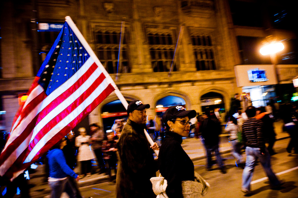 Obama Election Night in Grant Park, Chicago..Marguerite and Ralph (carrying flag) Moore from Chicago, walking on Michigan Avenue after the victory of Barrack Obama..Photographer: Chris Maluszynski /MOMENT