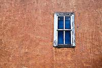 Adobe wall and window. Santa Fe, New Mexico.