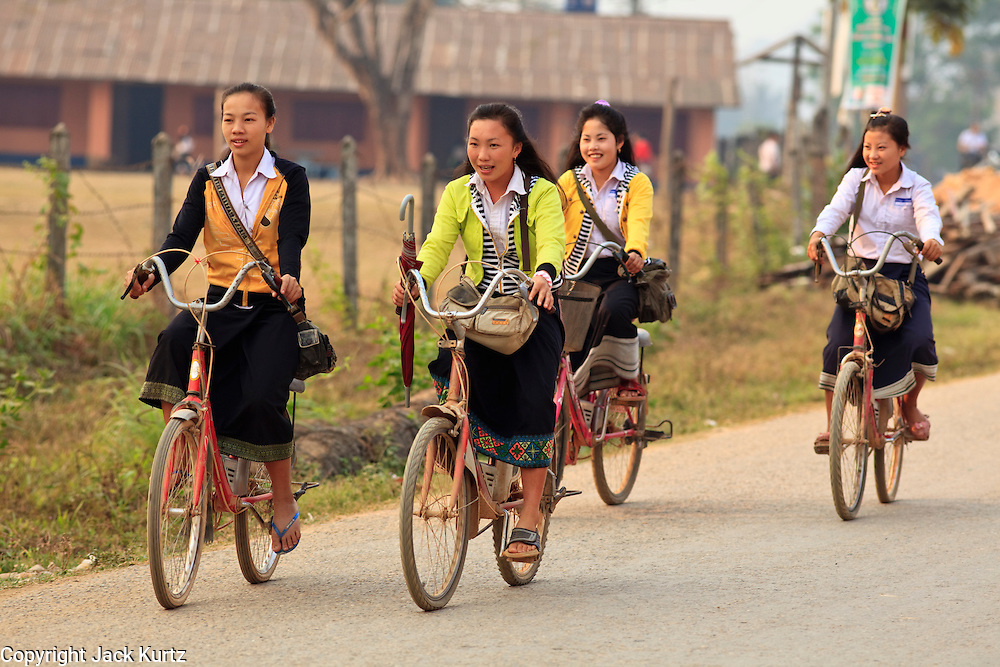 Mar. 13, 2009 -- VANG VIENG, LAOS: Girls pedal their bikes to school in Vang Vieng, Laos. Photo by Jack Kurtz