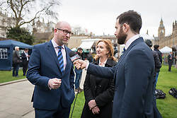 © Licensed to London News Pictures. 29/03/2017. London, UK. PAUL NUTTALL, leader of UKIP, speaks to the press on College Green outside Parliament. Prime Minister Theresa May will trigger Article 50 today, which will begin formal proceedings for Britain to leave the European Union. Photo credit: Rob Pinney/LNP
