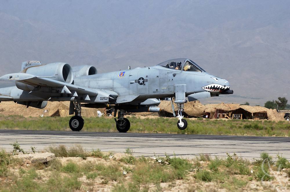 """A U.S. Air Force Fairchild-Republic A-10 Thunderbolt II aircraft takes off for a patrol from Bagram airbase June 11, 2002 in Bagram Afghanistan. The A-10, also known as the """"Warthog"""", is a single seat, close air support (CAS) aircraft that is deployed to protect troops and attack ground targets in Afghanistan as part of Operation Enduring Freedom."""