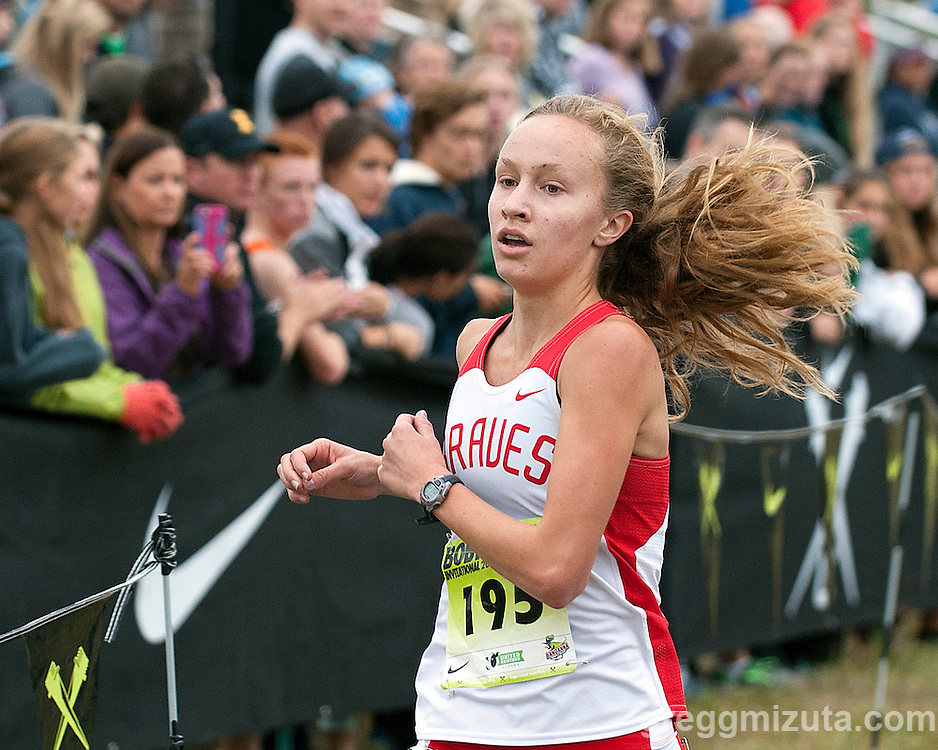 Boise's Emily Hamlin crosses the finish line at the Bob Firman Invitational Elite girl's race on September 27, 2014 at Eagle Island State Park, Eagle, Idaho.<br />