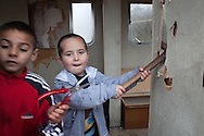 Kids are playing in an abandoned caravan, that will be reselled in a junk yard. //  France is the land of destination of many Roma people in their diaspora across Europe, who live camped in many settlements at the outskirts of cities. In 2013, the French Government has expelled thousands of Gypsies from the East as in 2010, 2011 and 2012, this time without any financial aids. Many Roma live afraid to be expelled but they remain in the French country with the hope of receiving some kind of aid. Outskirts of Lille, France. December 2013.
