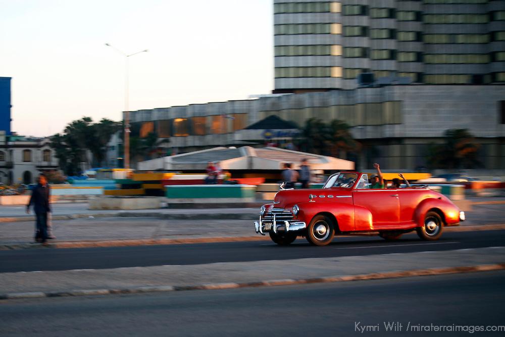 Central America, Cuba, Havana. A classic convertible along the Malecon, Havana.
