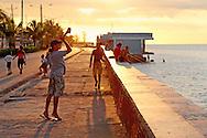 Fishing on the Malecon in Manzanillo, Granma, Cuba.