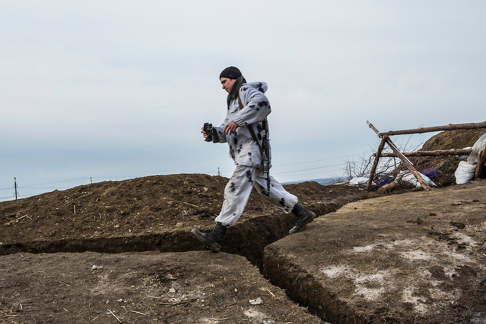 GORLOVKA, UKRAINE - JANUARY 31, 2015: A rebel fighter moves along a front-line position in Gorlovka, Ukraine. Fighting in Ukraine has intensified over the last week, with rebels declaring the end of a September ceasefire. CREDIT: Brendan Hoffman for The New York Times