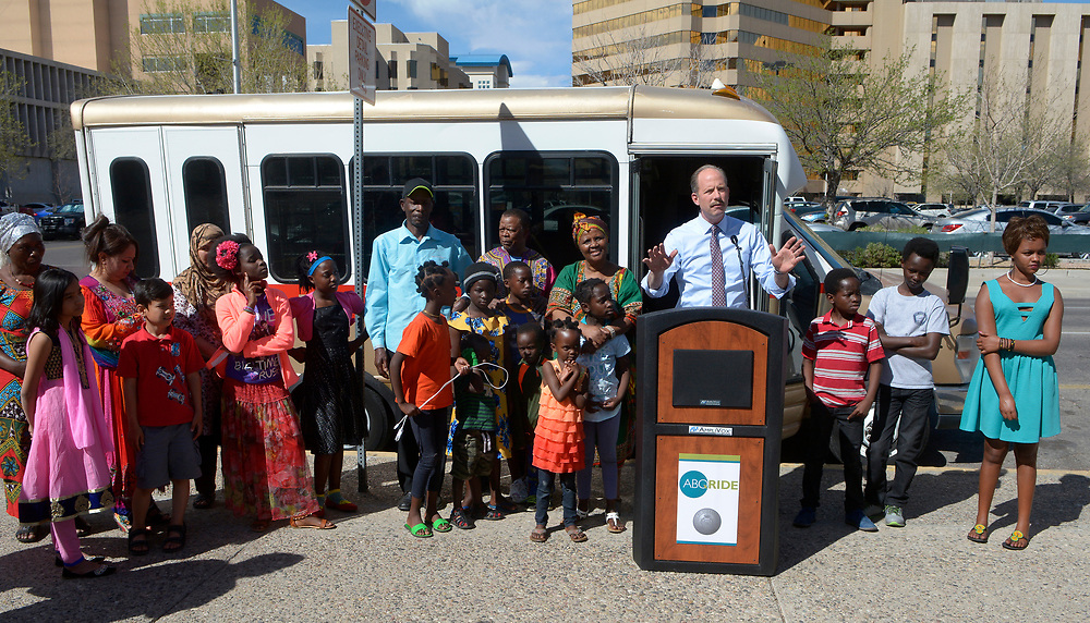 gbs032017j/ASEC -- Albuquerque Mayor Richard Berry donates a city transit bus to the Immigrant and Refugee Village of Albuquerque for the New Mexican Women's Global Pathways program which transports children and adults to English classes, during a ceremony on Monday, March 20, 2017.(Greg Sorber/Albuquerque Journal)