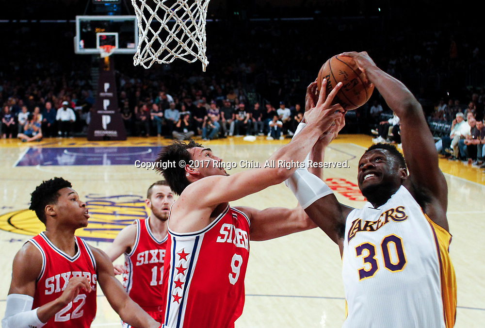 Los Angeles Lakers forward Julius Randle (#30) shoots against Philadelphia 76ers forward Dario Saric (#9) during an NBA basketball game Tuesday, March 12, 2017, in Los Angeles. <br /> (Photo by Ringo Chiu/PHOTOFORMULA.com)<br /> <br /> Usage Notes: This content is intended for editorial use only. For other uses, additional clearances may be required.