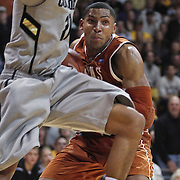 SHOT 2/26/11 4:56:56 PM - Colorado's Andre Roberson (#21) guards Texas' Gary Johnson (#1) during their regular season Big 12 basketball game at the Coors Events Center in Boulder, Co. Colorado upset the fifth ranked Texas 91-89. (Photo by Marc Piscotty / © 2011)
