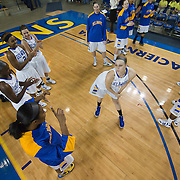 Delaware Senior Center Sarah Acker (51) (Right) get her imaginary photo taken by teammate Delaware Forward Danielle Parker (12) during player introductions prior the start of a Colonial Athletic Association conference Basketball Game against Northeastern Sunday, Feb. 26, 2012, at the Bob Carpenter Center in Newark, Del.