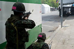 Thai soldiers fire on Red-shirt protestors during the military crackdown to end the Red-shirt protests.