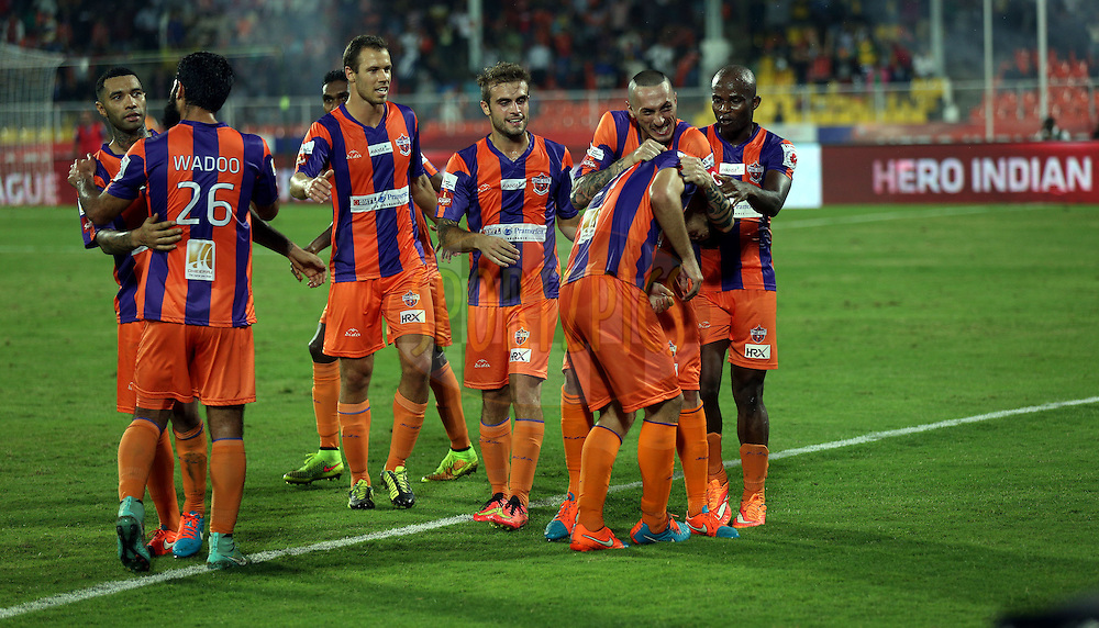 FC Pune City team celebrates the goal scored by Kostas Katsouranis of FC Pune City  during match 44 of the Hero Indian Super League between FC Pune City and Atletico de Kolkata FC held at the Shree Shiv Chhatrapati Sports Complex Stadium, Pune, India on the 29th November 2014.<br /> <br /> Photo by:  Sandeep Shetty/ ISL/ SPORTZPICS