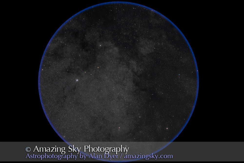 The Scutum starcloud in the northern summer Milky Way. Taken from home July 24, 2012, with the Canon 5D MkII at ISO 800 and 200mm lens at f/3.5 for a stack of 5 x 4.5 minute exposures. Messier 11, the Wild Duck Cluster, is at left, and M26 open cluster is at bottom.