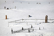 """SHOT 3/16/10 5:05:04 PM - Headstones peek out from beneath some deep snow at the Crested Butte Cemetery in Crested Butte, Co. The Crested Butte Cemetery was established in 1879 and is located about 1/2 mile northeast of the town of Crested Butte. The cemetery is located in a spectacular setting with the rugged beauty of Mt. Crested Butte as a backdrop. The cemetery is a great place to get a sense of the history of the area and many graves are those of miners from the early days of Crested Butte. Crested Butte is a Home Rule Municipality in Gunnison County, Colorado, United States. A former coal mining town now called """"the last great Colorado ski town"""", Crested Butte is a destination for skiing, mountain biking, and a variety of other outdoor activities. .(Photo by Marc Piscotty / © 2010)"""