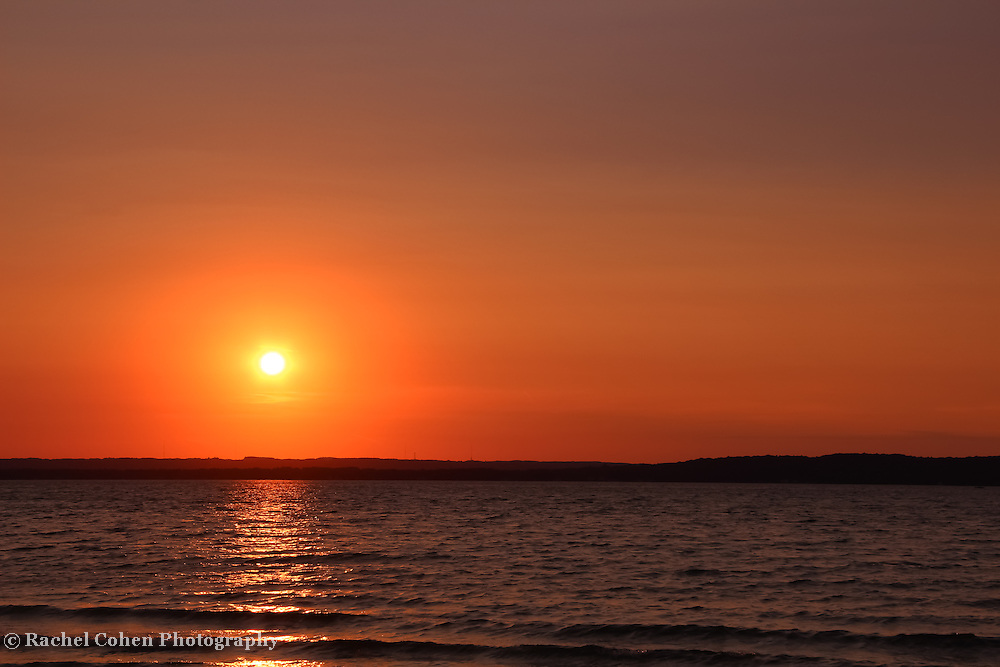 &quot;Grand Traverse Bay in Gold&quot;<br /> <br /> Scenic orange and gold sunset over Grand Traverse Bay in Michigan!!<br /> <br /> Sunset Images by Rachel Cohen