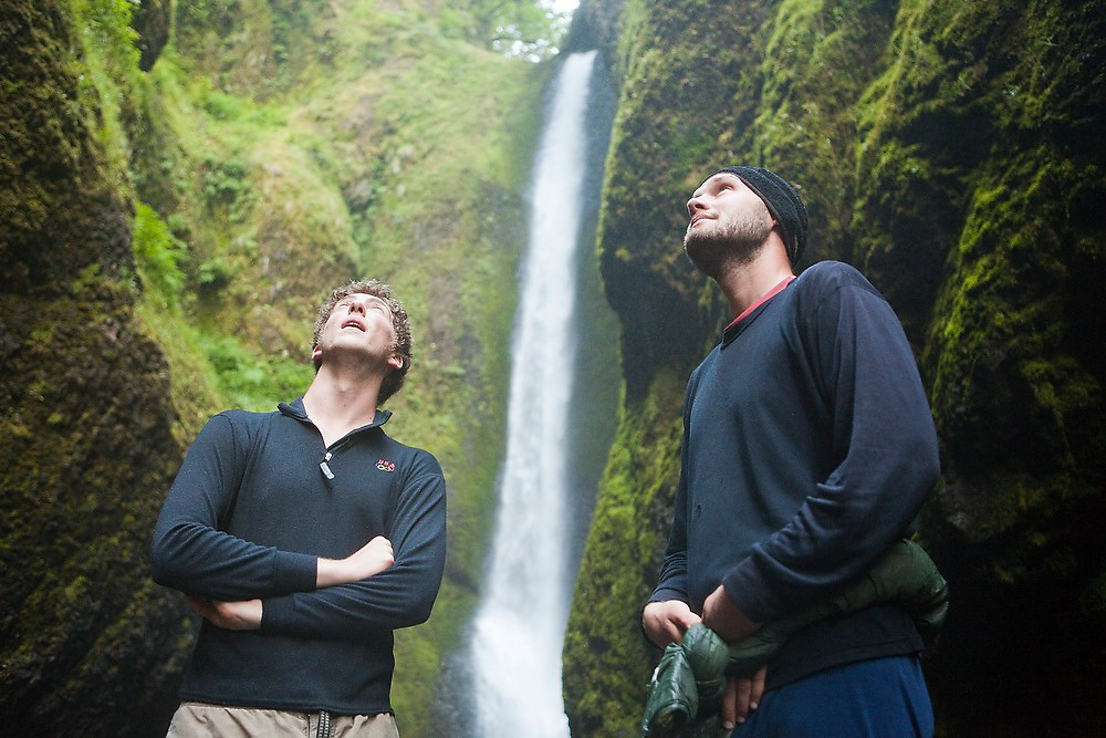 Hikers Zach Podell-Eberhardt (left) and Erik Greensfelder marvel at the towering walls of Oneonta Gorge, a mossy slot canyon cut into the bedrock in Oregon's Columbia River Gorge National Scenic Area.