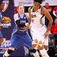 INDIANAPOLIS, IN - OCTOBER 21: Lindsay Whalen #13 of the Minnesota Lynx holds on to Erlana Larkins #2 of the Indiana Fever to cause a foul during Game Four of the 2012 WNBA Finals on October 21, 2012 at Bankers Life Fieldhouse in Indianapolis, Indiana. NOTE TO USER: User expressly acknowledges and agrees that, by downloading and or using this Photograph, user is consenting to the terms and conditions of the Getty Images License Agreement. (Photo by Michael Hickey/Getty Images) *** Local Caption *** Lindsay Whalen; Erlana Larkins