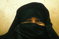 veiled teenage girl in Lamu, Kenya - Photograph by Owen Franken