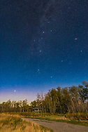 The autumn constellations of Perseus, Andromeda and Cassiopeia rising above autumn trees at Maskinonge picnic area in Waterton Lakes National Park, on a moonlit night, September 20, 2015. This is a single 20-second untracked exposure with the Nikon D750 at ISO 1600 and the Sigma 24mm lens at f/2.8.