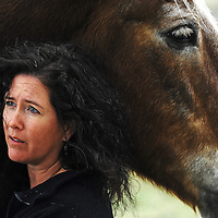 Deborah Derr founder of United in Light Draft Horse Sanctuary stands by Moonbeam, a Belgian draft horse Derr adopted preventing the animal from being slaughtered.