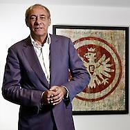 Frankfurt am Main | 15.05.2011..Peter Fischer, Praesident Eintracht Frankfurt, Portrait mit Vereinswappen/Logo in der Vereinszentrale am Riederwald in Frankfurt...©peter-juelich.com..[No Model Release | No Property Release]