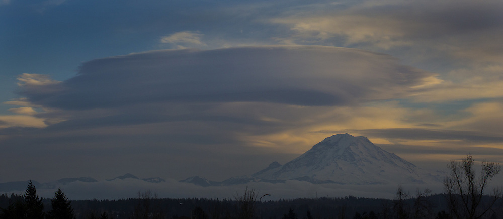 A huge cloud hovers over Mount Rainier. This view is from Kent. (Ellen M. Banner / The Seattle Times)