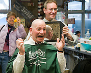 NEWS&GUIDE PHOTO / PRICE CHAMBERS.Garth Dowling from Jackson, Wyo. reacts to the first glimpse of his new hairstyle at Teton Barbershop on March 22, 2010, as barber Mike Randall holds a mirror. Dowling and more than 50 others shaved their heads in support of the cancer awareness effort and fund raiser called St. Baldrick's.