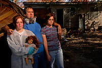 """""""We evacuated the day of the hurricane and couldn't take all of the pets. We lost the yellow lab, along with one of the cats...Everything's destrroyed and we're just going to have to decide how to put parts of our lives back together.""""..Eldon Silva and his daughters Mary, left, 13, and Adele, 15 lost a dog, cat, and their entire home in St. Bernard's Parish to the floods following Hurricane Katrina, and now are living in Georgia until they know what's next. Thursday, Nov. 3, 2005.  (Robert Caplin/The New York Times)...."""