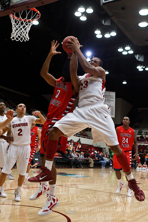 Nov 14, 2011; Stanford CA, USA;  Stanford Cardinal guard Gabriel Harris (23) grabs a rebound from Fresno State Bulldogs forward Jerry Brown (0) during the first half of a preseason NIT game at Maples Pavilion. Mandatory Credit: Jason O. Watson-US PRESSWIRE
