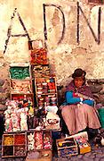 BOLIVIA, LA PAZ street vendor in the Mercado de Hechiceria selling magic potions for ailments of love, health and sex