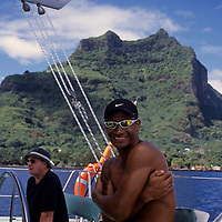 Oceania, South Pacific, French Polynesia, Tahiti, Bora Bora. Polynesian captain on catamaran cruise around Bora Bora.