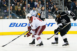 David Schlemko (Phoenix Coyotes, #6) vs Wayne Simmonds (Los Angeles Kings, #17) during ice-hockey match between Los Angeles Kings and Phoenix Coyotes in NHL league, March 3, 2011 at Staples Center, Los Angeles, USA. (Photo By Matic Klansek Velej / Sportida.com)