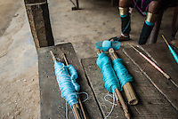 Colorful blue thread for the weaving of shawls for sale in a tourist market near Mae Hong Son, Thailand