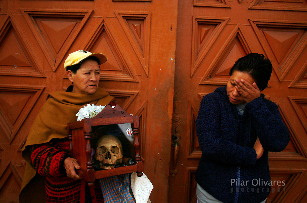 A woman carry skulls into a church to be blessed during the Day of Skulls at the General Cemetery in La Paz November 8, 2009. Bolivians who keep close relatives' skulls at home as a macabre talisman flock to the cemetery chapel once a year to have the craniums blessed and to bring themselves good luck in the future.