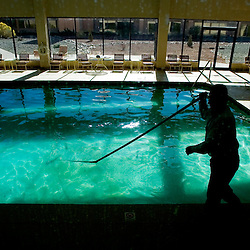A maintenance person cleans a pool in Gallup, New Mexico.