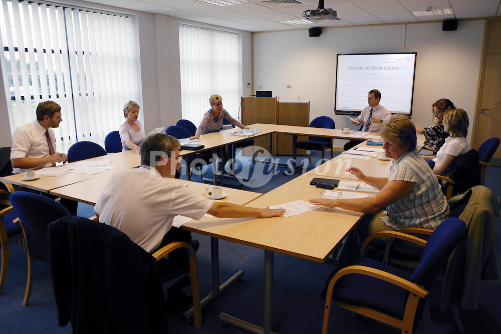 Group of employees at a teamwork meeting at NHS Octavia House,
