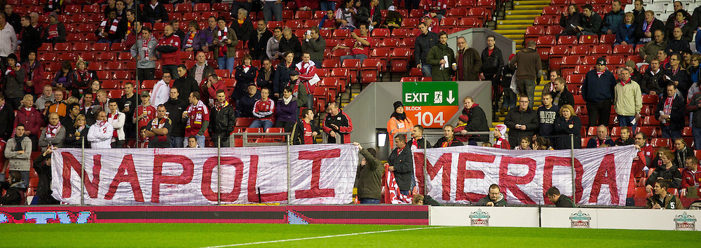 LIVERPOOL, ENGLAND - Thursday, November 4, 2010: Liverpool's supporters on the Spion Kop hold up a banner directed at the SSC Napoli fans reading 'Napoli Merda' which translates as 'Napoli Shit' a reference to the filthy state of the city of Napels during the UEFA Europa League Group K Matchday 4 match at Anfield. (Photo by David Rawcliffe/Propaganda)