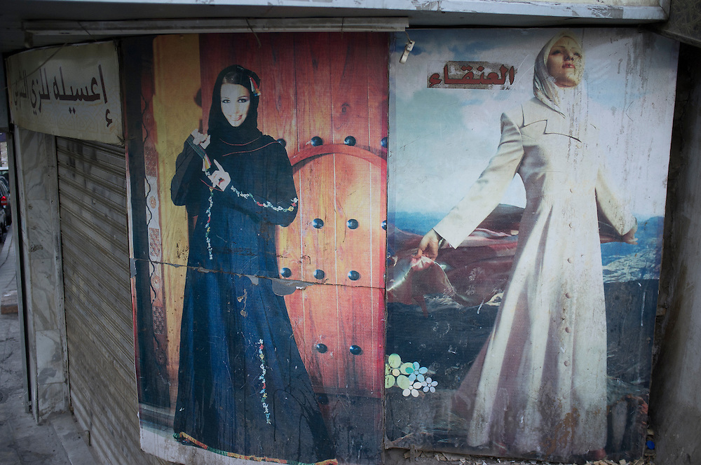 JORDAN<br /> <br /> Veils in the streets of Amman.<br /> <br /> Jordan is an Arab kingdom in the Middle East, on the East Bank of the Jordan River. Jordan is bordered by Saudi Arabia to the south and east, Iraq to the north-east, Syria to the north, and Israel to the west.