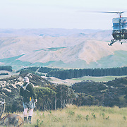 helicopter hauling a red stag in new zealand