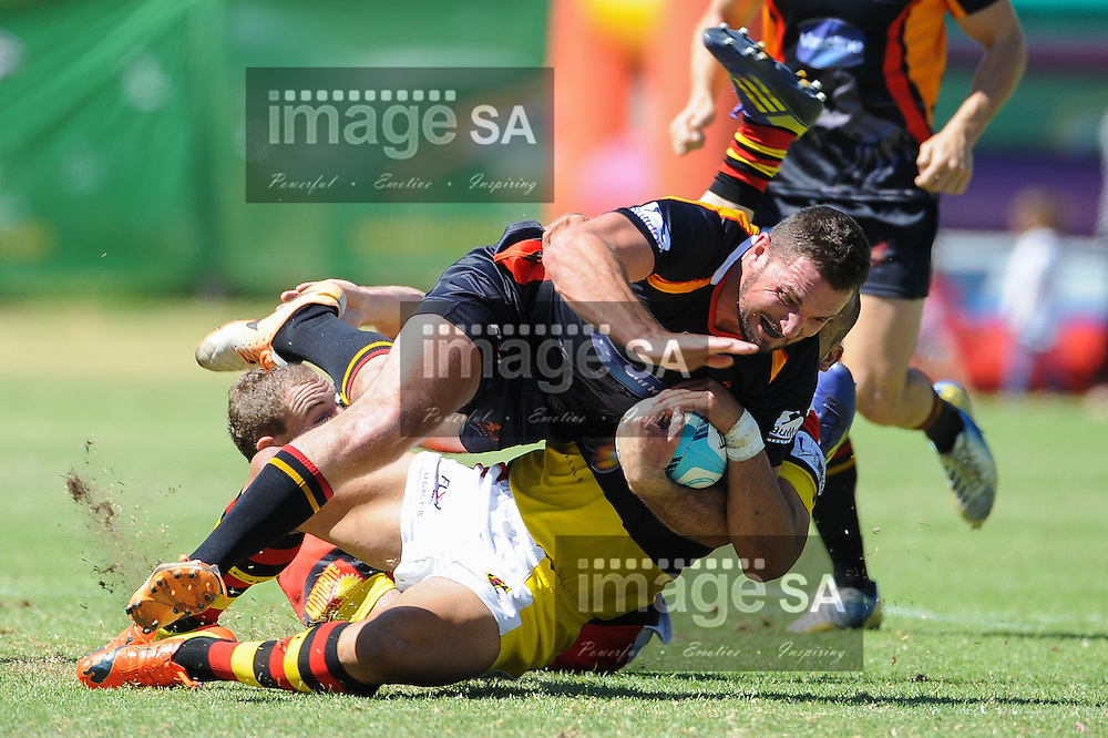 CAPE TOWN, SOUTH AFRICA - Saturday 28 February 2015, Clayton Kelly of Vaseline Wanderers is tackled during the second round match of the Cell C Community Cup between Hamiltons and Vaseline Wanderers at the Stephan Oval, Green Point.<br /> Photo by Roger Sedres/ImageSA/SARU
