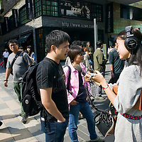 BEIJING, OCT. 6 : Chinese are interviewed outside th Apple store in Beijing.