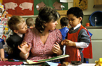 A teacher helping children at  a South  London preparatory school.