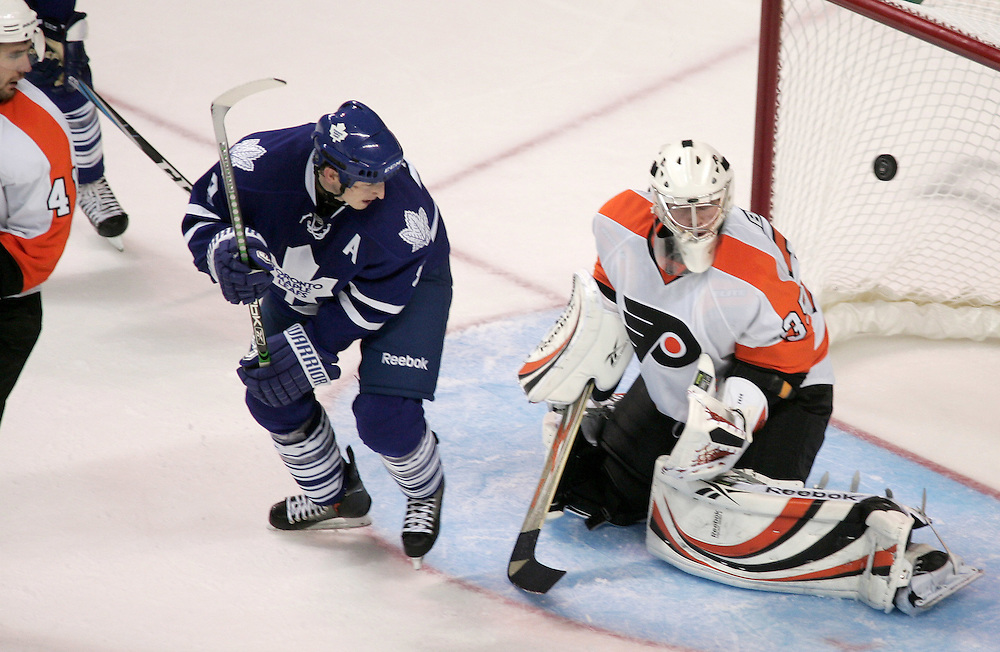 Colby Armstrong(9) of the Toronto Maple Leafs watches as his tying goal fly past Philadelphia Flyers goalie Sergei Bobrovsky during an NHL exhibition game at the John Labatt Centre in London, Ontario, September 23, 2010. The Leafs defeated the Flyers 3-2 in a shootout.<br /> REUTERS/Geoff Robins (CANADA)
