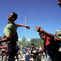 Palestinian youths throw rocks at Israeli forces in Dayr al Balah, in the Gaza Strip. (Photo/Scott Dalton)