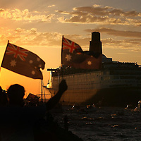 2-SPOT NEWS.Paul Kane (Getty Images).The Queen Elizabeth II (QE2) cruise liner departs Fremantle for the final time.