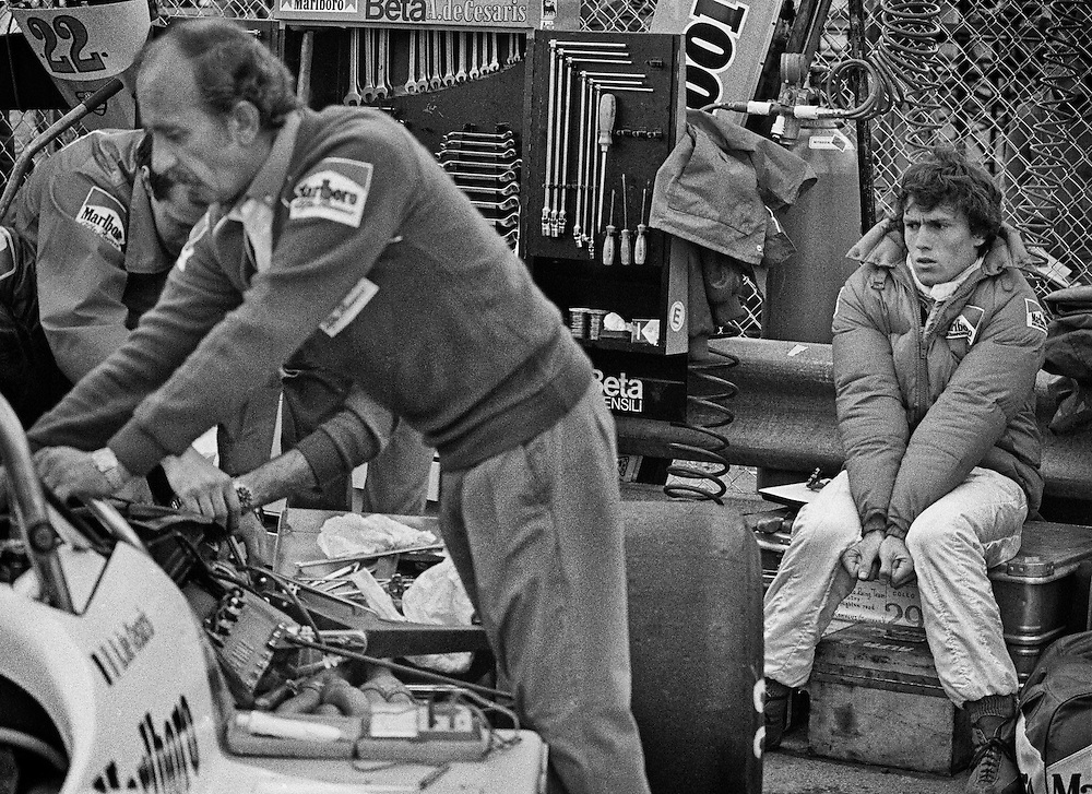 Having qualified second for the 1982 Detroit Grand Prix, Italy&rsquo;s Andrea de Cesaris stretches to burn off nervous energy while engineer Ermanno Cuoghi prepares his Marlboro Alfa-Romeo before the start. <br />